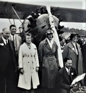 Laura Jean Candy posed with her pilot William Engle prior to their flight in his biplane from Langhorne's Silver Star Airport on May 15, 1938.