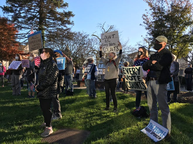 Demonstrators support the Count Every Vote rally in Doylestown on Wednesday.