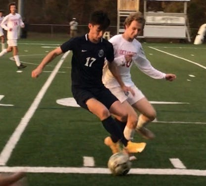Aidan Davis (17) of St. Augustine outraces Sergio Miller of Ocean City for the ball Tuesday. Davis scored all three goals in a 3-0 St. Augustine win.