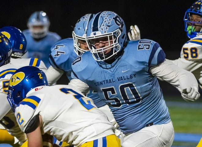 Central Valley defensive lineman Sean FitzSimmons tackles East Allegheny quarterback Johnny DiNapoli in the Warriors' win last week in the WPIAL 3A quarterfinals.