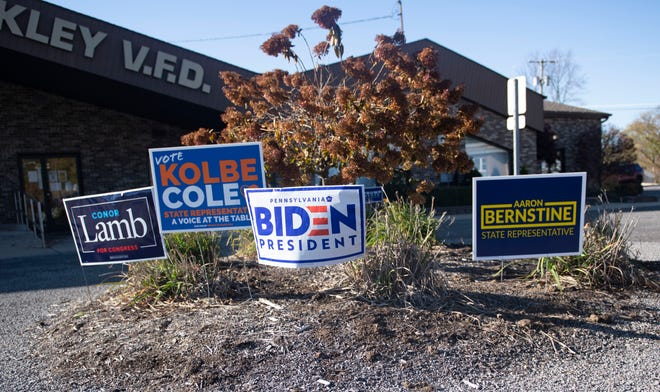 Campaign signs dot an island in front of the North Sewickley Volunteer Fire Department on Nov. 3 as voters enter the building to cast their votes.