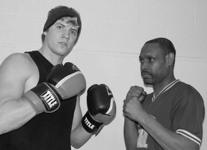 One of the up-and-coming fighters Verdell Smith, right, has help train is Kenzie Morrison, left, the son of former heavyweight boxing world champion Tommy Morrison. Kenzie trained and worked in Bartlesville for several months in the mid-2010's, and made his ring debut as a amateur at a fight show in Dewey.