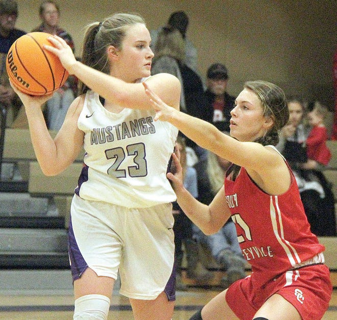 Rachel Hopkins, left, powers up for Wesleyan Christian School during varsity girls basketball action last season.