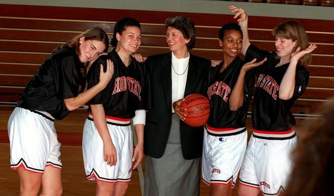 OSU coach Nancy Darsch and her seniors ham it up before their official portrait is taken on Nov. 1, 1995. From left are Lisa Negri, Gigi Jackson, Darsch, Adrienne Johnson and Katie Smith.