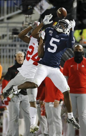 Penn State receiver Jahan Dotson (5) makes a catch against Ohio State cornerback Shaun Wade in the Buckeyes' victory last Saturday. Dotson scored three touchdowns against OSU, including two when covered by Wade in the fourth quarter.
