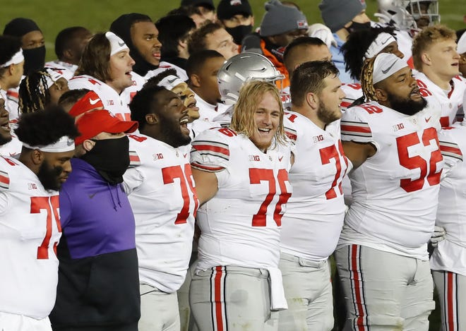 "Ohio State guard Harry Miller (76) joins fellow linemen B Thayer Munford (75), Nicholas Petit-Frere (78), Josh Myers (71) and Wyatt Davis (52)  in singing ""Carmen Ohio"" after their 38-25 win over Penn State two weeks ago."