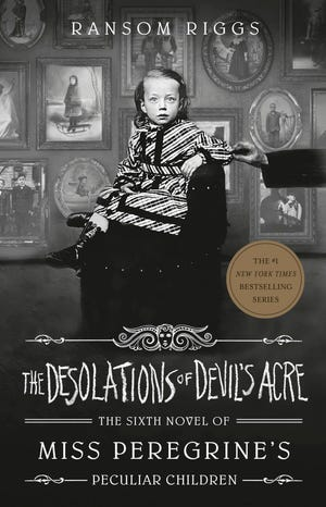 "This cover image released by Penguin Young Readers shows ""The Desolations of Devil's Acre"" by Ransom Riggs, the final installment of the bestselling Miss Peregrine's Peculiar Children series. It will be published Feb. 23."