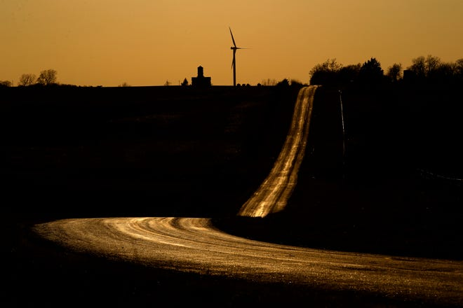 An empty country road glows as the sun sets March 29, 2020, near King City, Missouri.