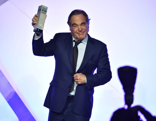 """Filmmaker Oliver Stone accepts the IFP """"Tribute"""" award at the 26th Annual Gotham Independent Film Awards at Cipriani Wall Street on Monday, Nov. 28, 2016, in New York. (Photo by Evan Agostini/Invision/AP)"""
