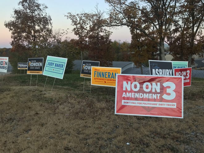 Signs for Missouri candidates and Amendment 3, staked in the grass near the Mizzou Arena parking lot on Tuesday.