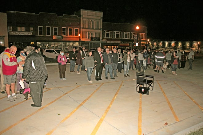 Taking advantage of unseasonably-mild temperatures around 60 degrees and virtually no wind, a sizable number of persons joined candidates and their families on the east parking lot of the Livingston County Courthouse in Chillicothe (Mo.) to watch the posting of up-to-the-minute 2020 general election returns Tuesday evening, Nov. 3.