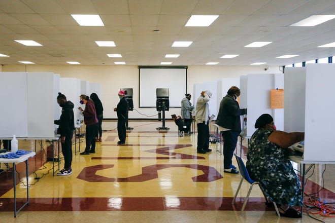 Voters cast their ballots during Election Day on Tuesday, Nov. 3, 2020 at the Linden Community Center in Columbus, Ohio.