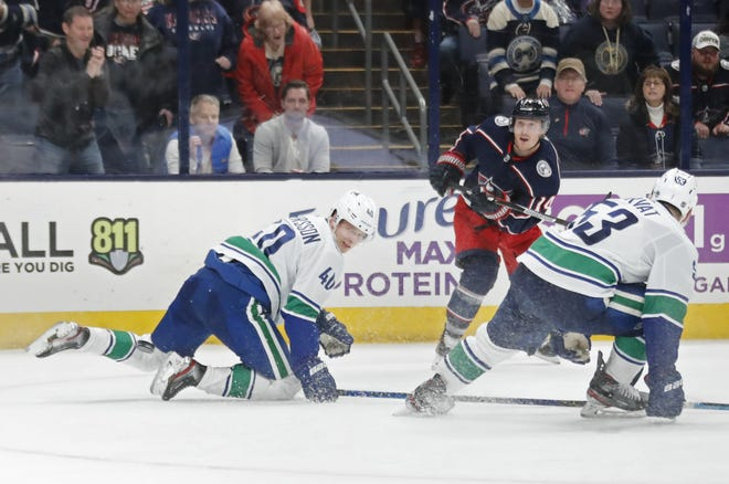 Blue Jackets forward Gustav Nyquist (14), shown here scoring an empty-net goal against Vancouver in March, will miss up to six months after undergoing shoulder surgery.