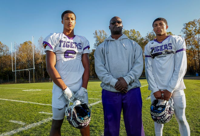 Former Ohio State and NFL football player Lorenzo Styles is currently a defensive backs coach at Pickerington Central where his sons, Lorenzo Jr., right, is a senior wide receiver and Sonny is a sophomore defensive back.