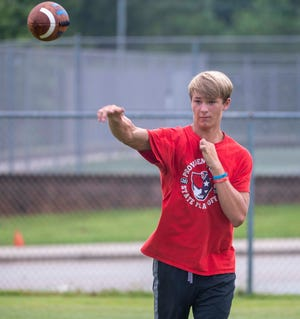 Providence Grove's backup QB Chase Whitaker throws the ball during a workout on Aug. 6.