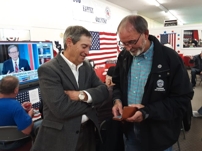 Rep. Sam Watford (left) who was elected to N.C. House District  80 checks election results with Rep. Larry Potts who was re-elected as the representative of N.C. House District 81 at Davidson County Republican Headquarters on Tuesday.