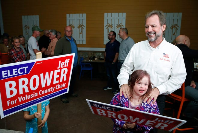 Jeff Brower with his granddaughter Ashlyn while  leading the race for County Chair, Tuesday, Nov. 3, 2020. at the Bahama Breeze restaurant in Daytona Beach.