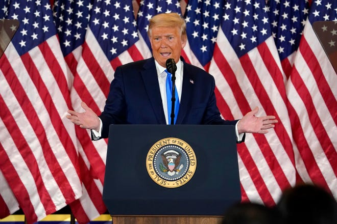 President Donald Trump speaks in the East Room of the White House early Wednesday.