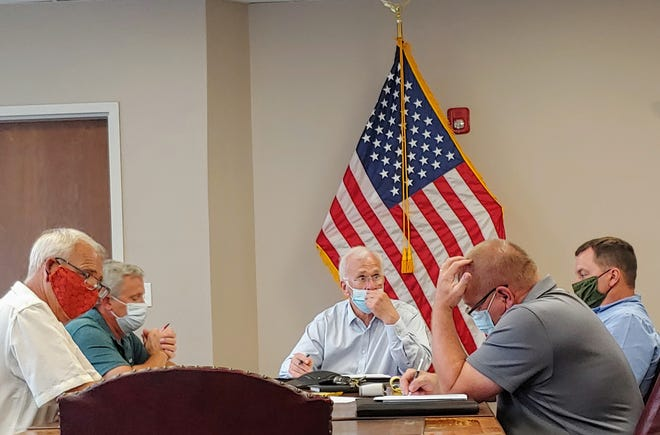 Village of Wellsville Mayor Randy Shayler, center, and Trustee Ed Fahs, second from left, were reelected Tuesday night.
