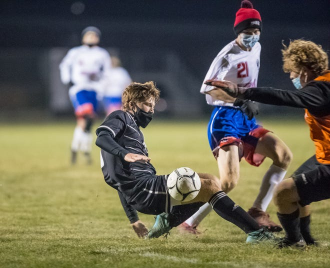 Jasper-Troupsburg senior Noah Price collides with the Campbell-Savona goalie going for a goal Tuesday night.