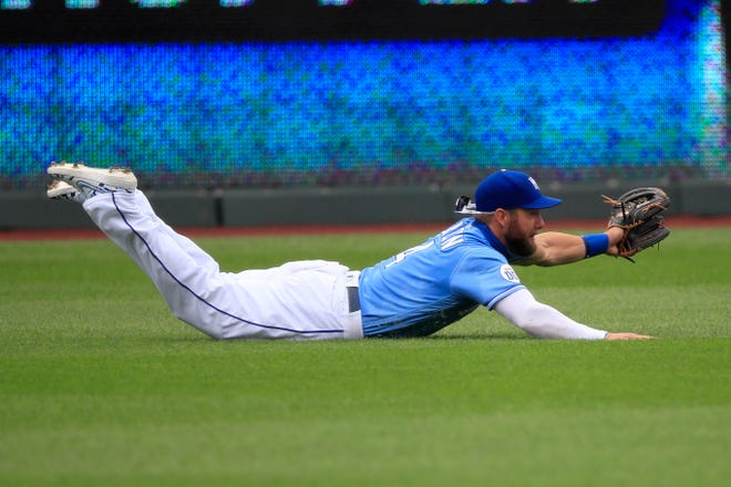 Kansas City Royals left fielder Alex Gordon makes a diving catch in a game against the Minnesota Twins in August. Gordon won his eighth Gold Glove - and fourth straight - in his final major league season.