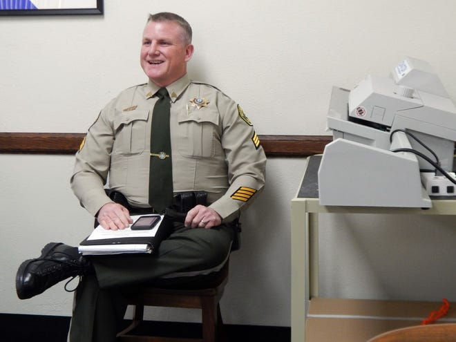 Des Moines County Sheriff-elect Kevin Glendening sits next to the auditor's new absentee ballot-counting machine Wednesday during the Des Moines County Board of Supervisors meeting at the Des Moines County Courthouse. Glendening won in a landslide with nearly 70% of 19,037 votes cast.