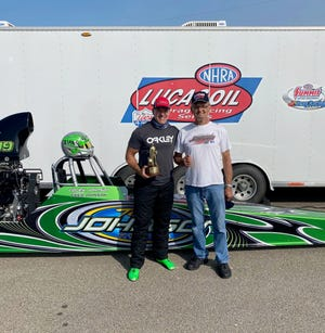 Corey Johnson (left) and his father, Fred Johnson of Middletown, have team up in NHRA drag racing.
