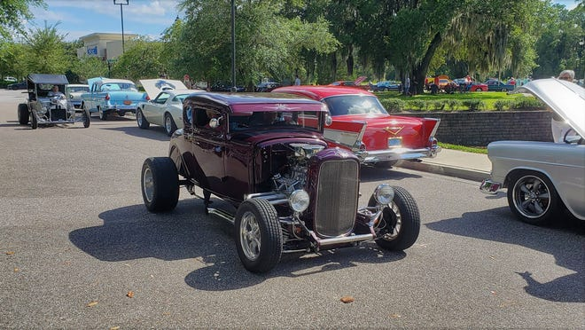 Hot rods cruise for parking spots at a recent Cruise Fruit Cove.