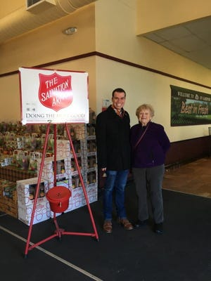 Michael Nicholson, now Gardner mayor, rings a bell during last year's Salvation Army Red Kettle Campaign as Gardner Community Action Committee board member Terri Hillman looks on.