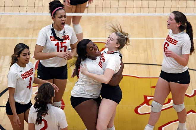Coronado's Aaliyah Gray (13) hugs Hunnie Zuber (1) during a District 4-5A match Nov. 3 against Abilene Wylie at Coronado High School. Gray and Zuber signed to play at the collegiate level Wednesday.