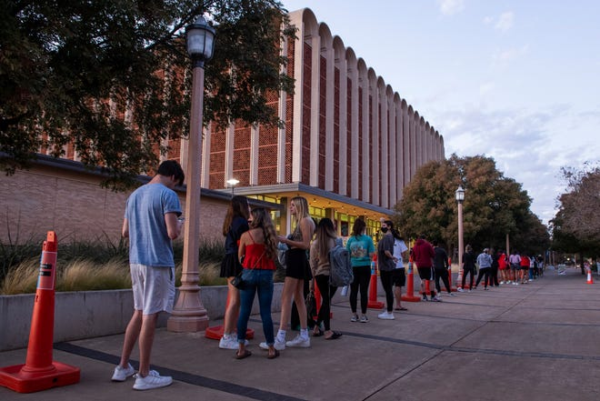 Voters stand in line to vote at the Texas Tech Library late in the day on Tuesday, Nov. 3, 2020, in Lubbock, Texas.