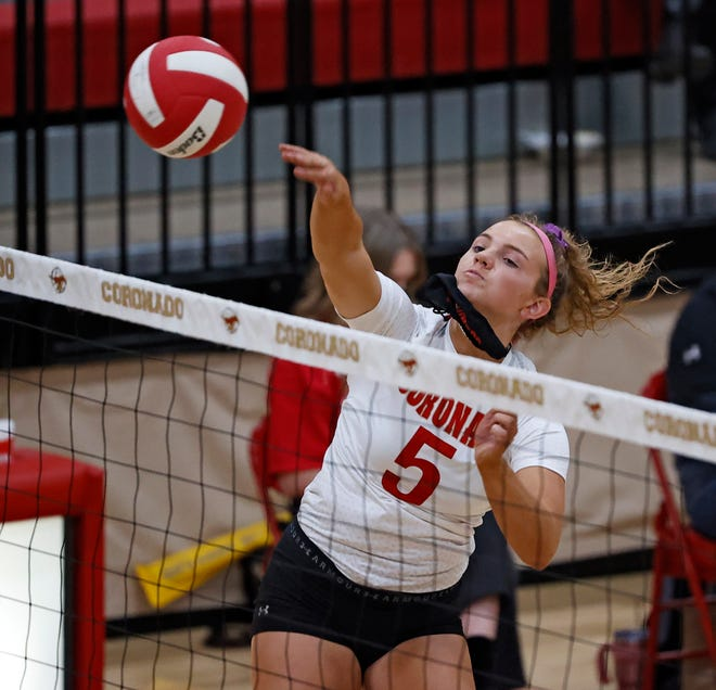 Coronado's Caroline Willcoxon (5) hits the ball over the net during a District 4-5A match Tuesday against Abilene Wylie at Coronado High School.