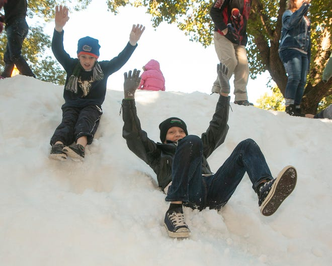 Lakeland's 40th annual Snowfest set for Dec. 4 and 5 will look a little different without a snow mountain for children to play on because of the COVID-19 pandemic. Last year, Kallen Athey, 8, left, and his brother, Caden Athey, 10, of Lakeland slid down the Snow Mountain.