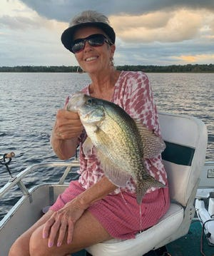 Marrianne Cox of Frostproof caught this speckled perch while fishing at Lake Walk-in-the-Water this week.