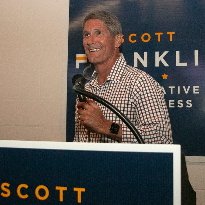 Scott Franklin, Republican winner of the U.S. House-District 15 seat, smiles as he steps up to the podium to address supporters during his election party at The Yard on Mass in Lakeland Tuesday night.