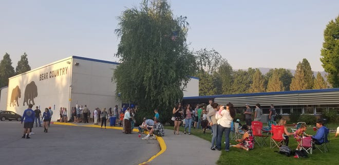 Families gather on the lawn in front of Mount Shasta High School for a Back to School celebration in 2017.
