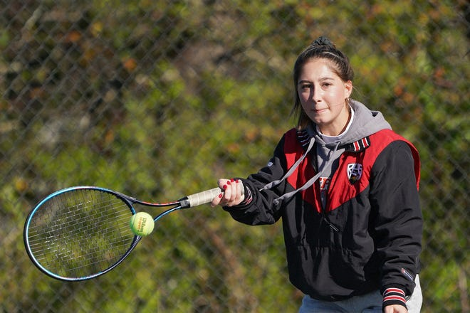 Grace Burgess rallied for a victory at No. 4 singles that helped Rogers beat West Warwick on Saturday.