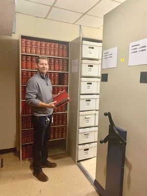 Anderson County Circuit Court Clerk Rex Lynch shows how some of the courts' records are being organized and preserved.
