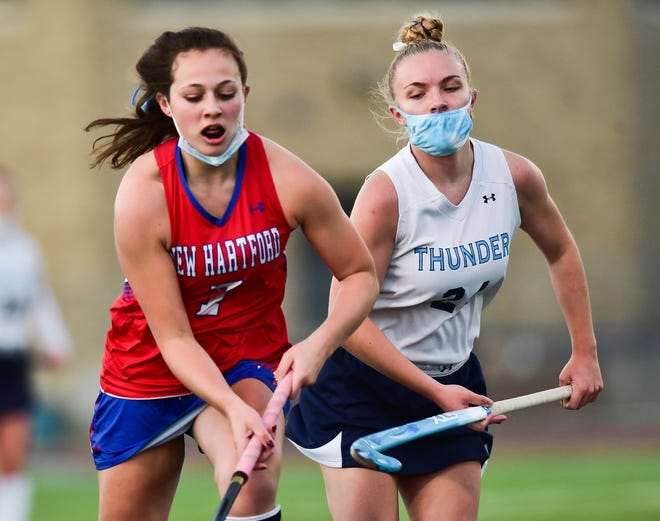 New Hartford player Ella Greico, left, moves the ball against Central Valley Academy player Hanna DeLuca during a field hockey game on Wednesday at Central Valley Academy. Greico had two goals in a 5-0 win.