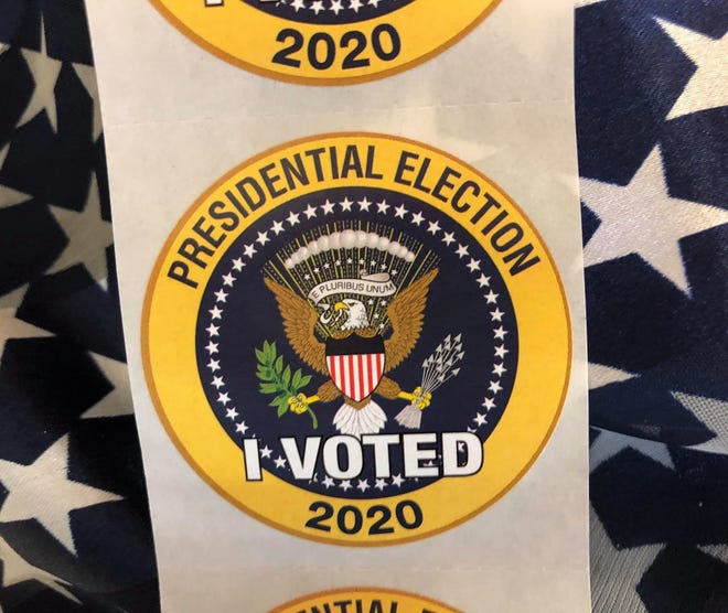 The new Presidential Election 'I Voted' stickers presented to voters at the polls in Hopewell, Va. on Nov. 3, 2020.