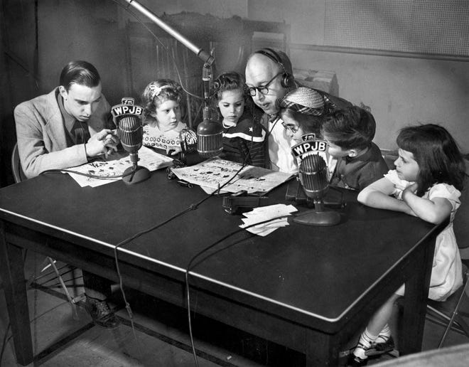 Uncle Eddie Pearson, center, and, from left, Morris Lambert, Bonny Gail Boren, Tina Feldman, Jean Ring, Eddie DeLisle and Pauline Auger, participate in a benefit for the Meeting Street School on WPJB in 1949. Pearson was a popular morning host for many years at WPJB AND WEAN.