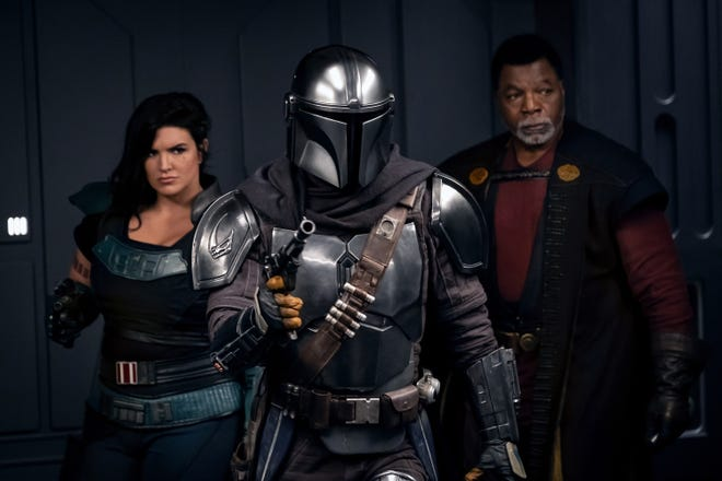 "Gina Carano stars as Cara Dune, Pedro Pascal as the title role, and Carl Weathers as Greef Karga in season two of ""The Mandalorian,"" now streaming on Disney+."