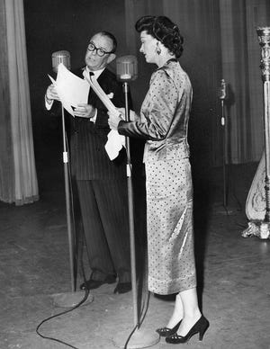 Stage and screen actress Ruth Hussey and Eddie Dowling, the Rhode Island-born theatrical producer, participate in the dedication program of The Providence Journal's FM station, WPJB-FM, in 1948.