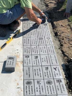The new Honor Walk features engraved bricks dedicated to veterans of military service.