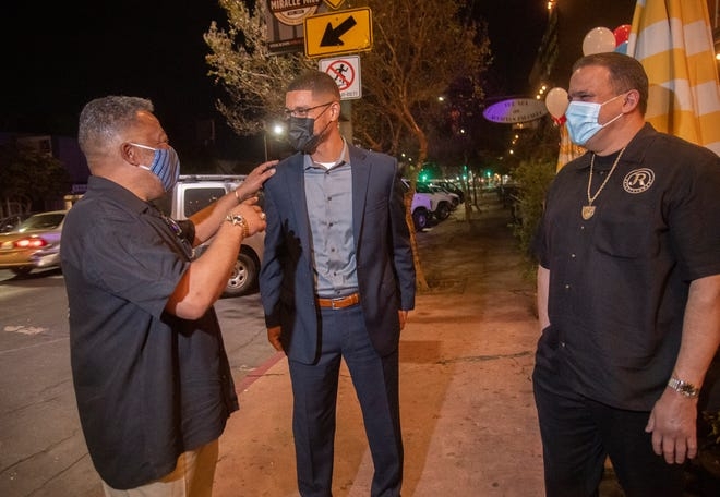 Stockton mayoral candidate Kevin Lincoln, center, greets supporters Rayford Hudson, left, and John Narvaez at an election night party at Ave on the Mile in Stockton.
