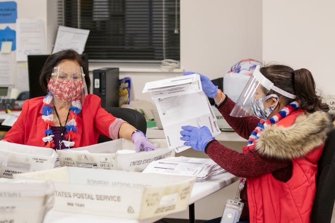 Victoria Atega, left, and Milagros Maghinay sort and inspect ballots  at the San Joaquin county Registrar of Voters Office where the votes are tabulated in Stockton on Tuesday.