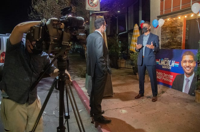 Stockton mayoral candidate Kevin Lincoln, right, is interviewed by FOX 40 at Ave on the Mile in Stockton on election night.