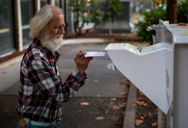 Gil Dunaway  casts his vote at the Lane County Elections drop box on Nov. 3, 2020, in Eugene, Oregon. Lane County has experienced a strong voter turnout for the 2020 election.