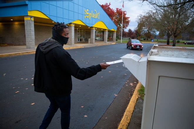 Givante Harshbarger from Springfield drops off his ballot on Election Day.