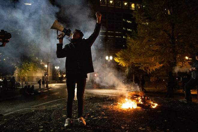 A Black Lives Matter protester chants slogans on Wednesday early morning, Nov. 4, in Portland.